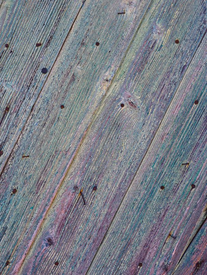 Detail of Textured Old Blue Painted Wooden Door stock images