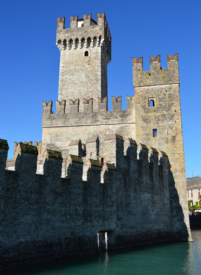 Detail of towers of Sirmione Scaliger Castle with medieval walls rare example of medieval port fortification, Sirmione, Lake Garda royalty free stock images