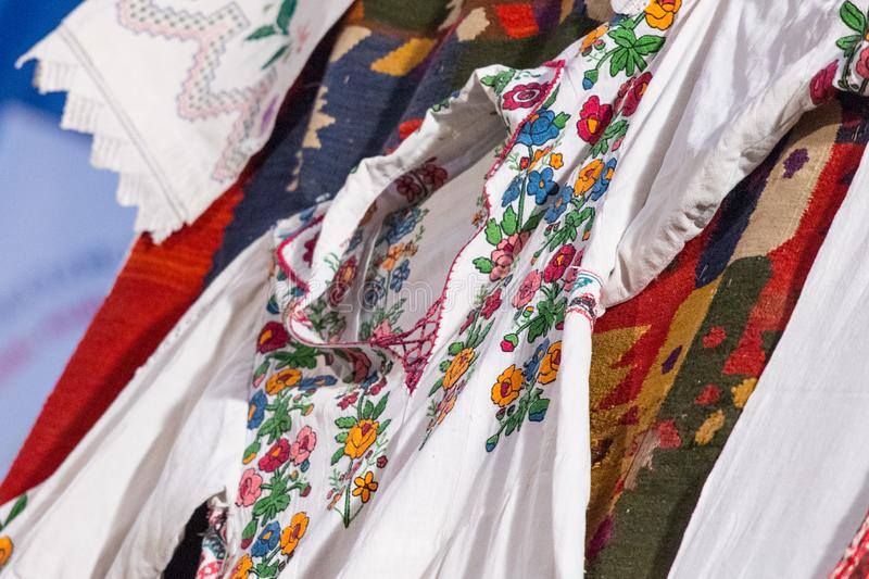 Detail of traditional folkloric costume of Romanian dancers. Folklore of Romania.  stock photo