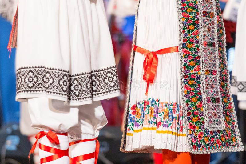 Detail of traditional folkloric costume of Romanian dancers perform a folk dance. Folklore of Romania.  royalty free stock photography