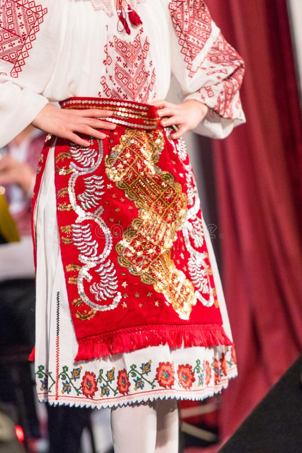 Detail of traditional folkloric costume of Romanian dancers perform a folk dance. Folklore of Romania royalty free stock photography