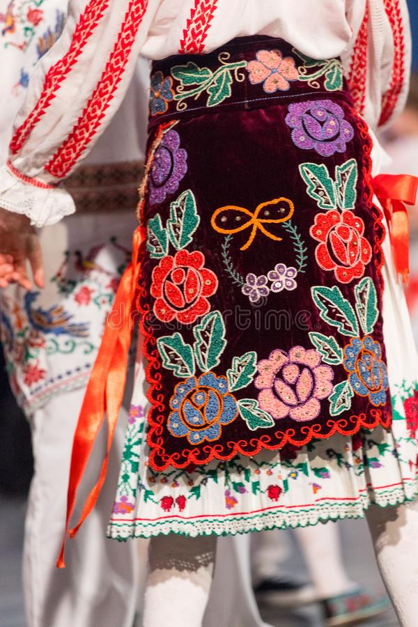 Detail of traditional folkloric costume of Romanian dancers perform a folk dance. Folklore of Romania.  royalty free stock photo