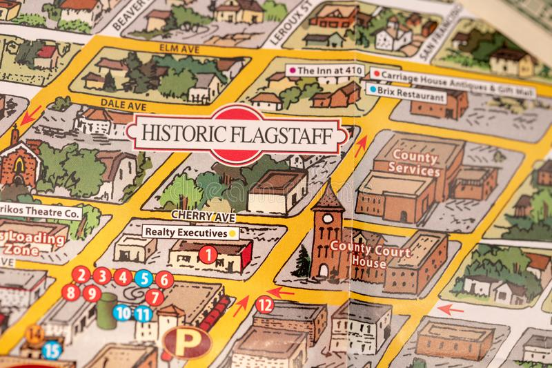 Detail of travel map Flagstaff, Arizona, USA with one Dollar bill just below the couthouse, justice and travel concept stock photography