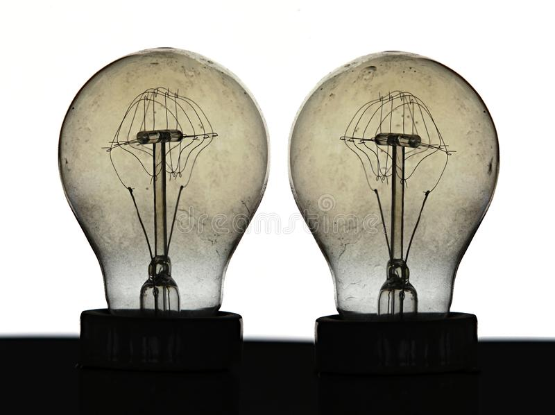 Light bulbs tungsten filament close detail. Detail on tungsten filament light bulbs, an obsolete lighting source with a base made of ceramic, a glass bulb vacuum royalty free stock photos