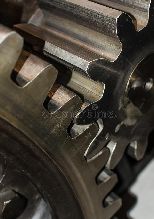 Detail of Iron Cog Wheels. Detail of two iron cog wheels with interlocked teeth royalty free stock image