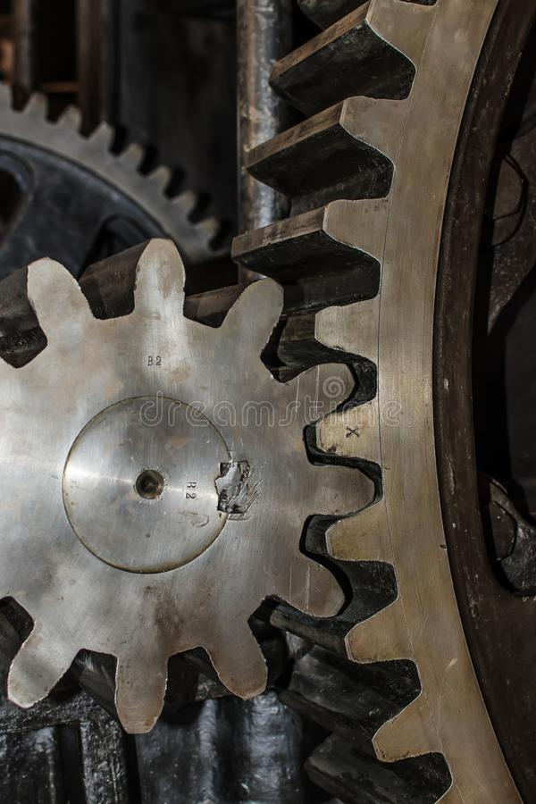 Detail of Iron Cog Wheels. Detail of two iron cog wheels with interlocked teeth royalty free stock images