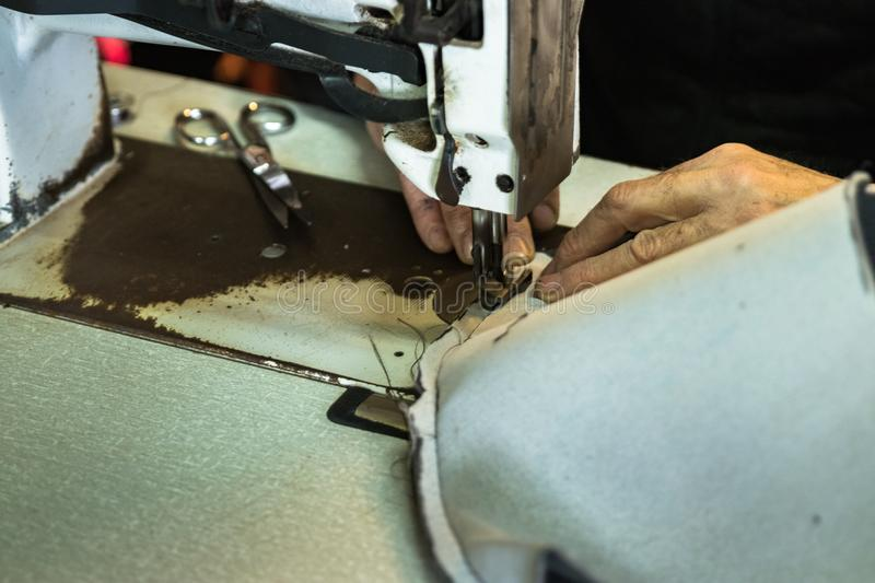 Upholsterer sewing upholstery cushion royalty free stock photography