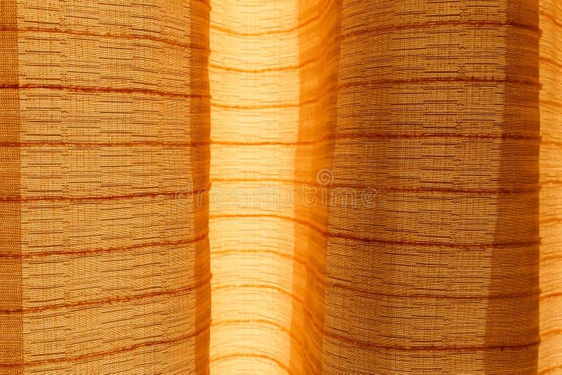 Detail van bruin gordijn stock foto's