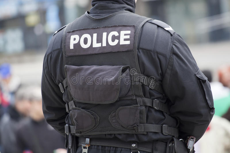Detail van een politieman stock foto's