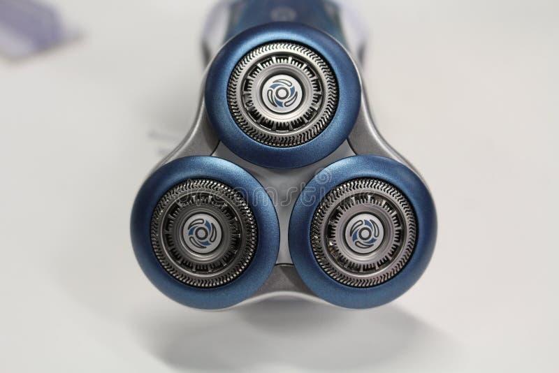 Detail van een roterend scheerapparaat - technologie - elektrisch toestel - apparaat - badkamers die - scheren - schoonheid - men royalty-vrije stock foto
