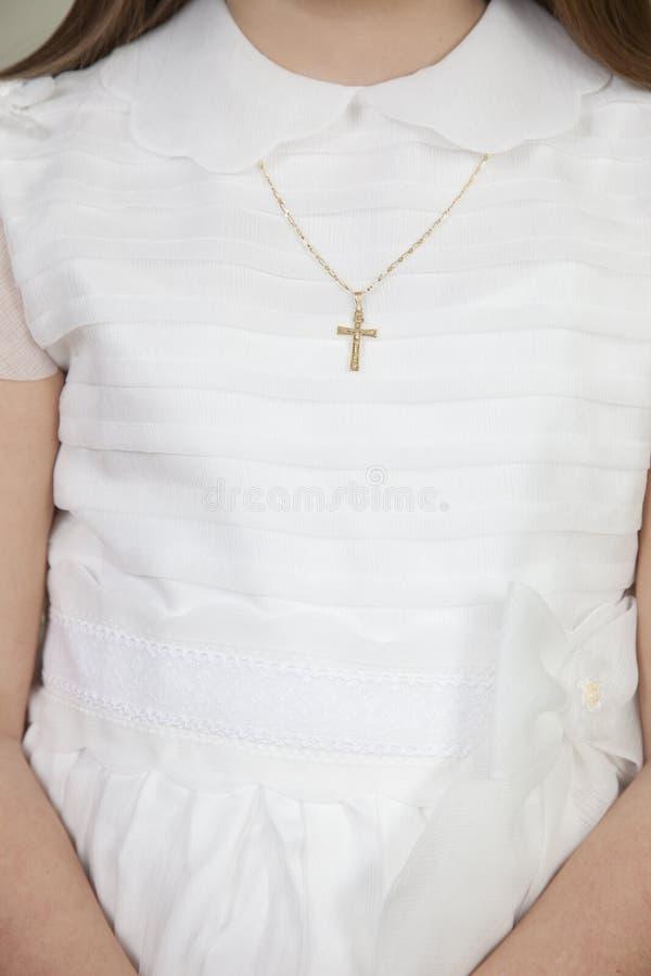 detail van meisje geklede whit een kruisbeeld royalty-vrije stock foto