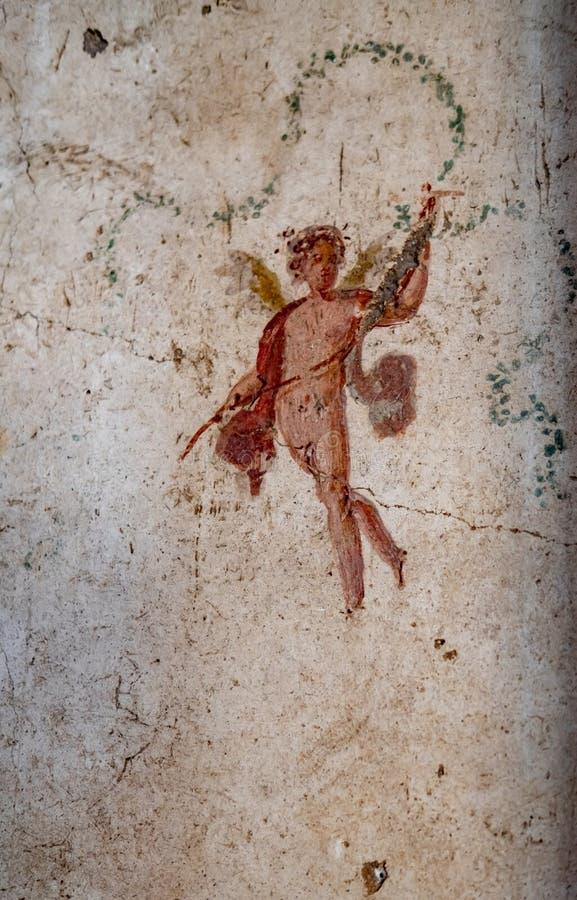 Detail van oude fresko van gevleugelde deities in een huis in Pompei stock fotografie
