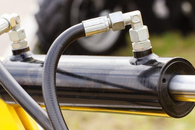 Detail van pneumatische of hydraulische machines, een deel van zuiger of actuator stock foto