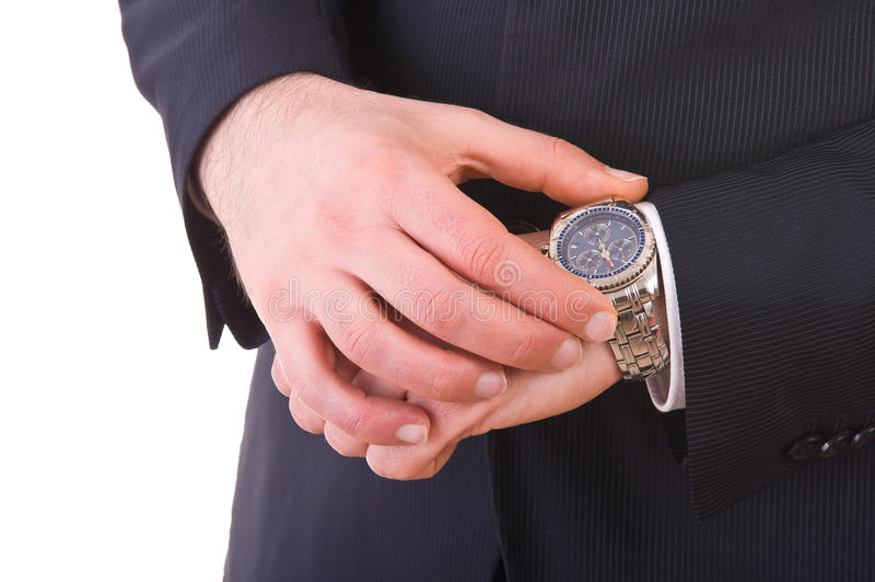 Zakenman die tijd controleren op zijn polshorloge. royalty-vrije stock foto