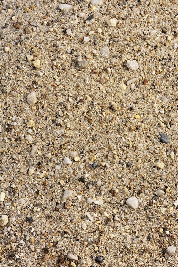 Detail van zandtextuur met kleine stenen royalty-vrije stock afbeeldingen