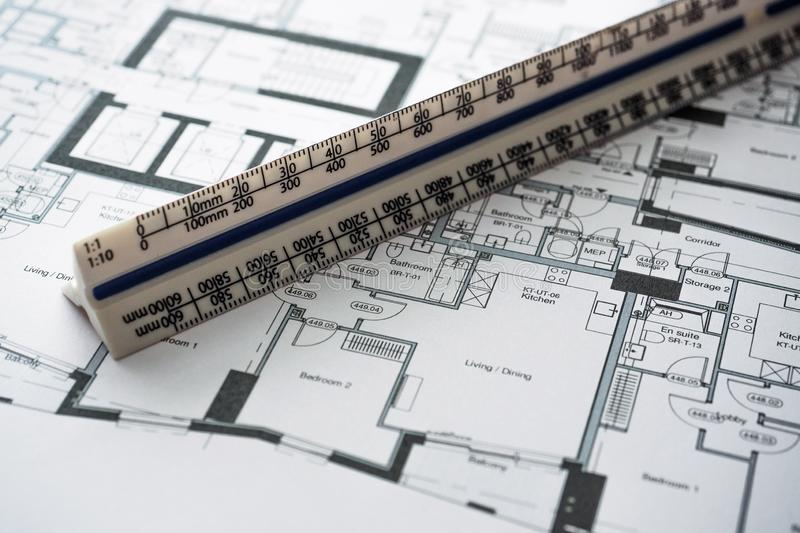 Detail view of architectural and structural construction drawings with designer tools. stock photo
