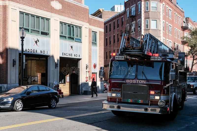 Boston Fire Department engine attending a call in the downtown area. Detail view of a Boston, MA fire truck seen moving away from its bay, attending an stock image