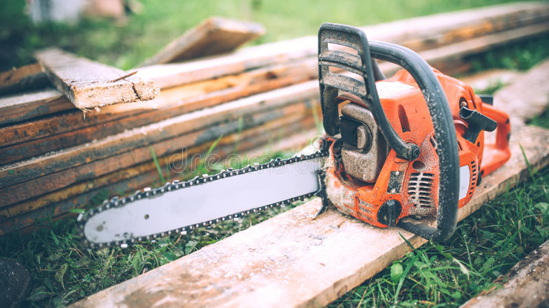 Detail view of chainsaw, construction tools, agriculture details. Gardening equipment. Close-up view of chainsaw, construction tools, agriculture details royalty free stock photo