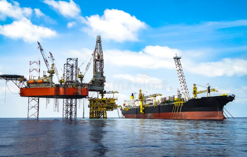 Detail view of drilling rig, platform and FPSO ship. This shot was taken from crew boat, shows of Big drilling rig on royalty free stock image