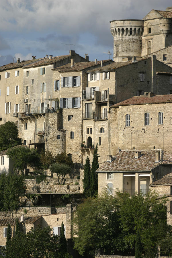 Detail view of Gordes hilltop town in the Luberon, France. Houses and church with windows in the sunshine royalty free stock photos