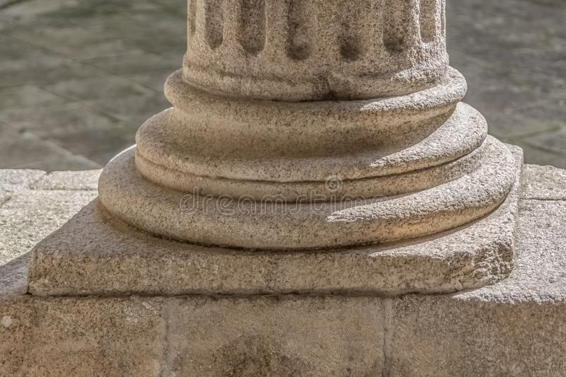 Detail view of a ionic style base column, romanesque columns gallery royalty free stock image