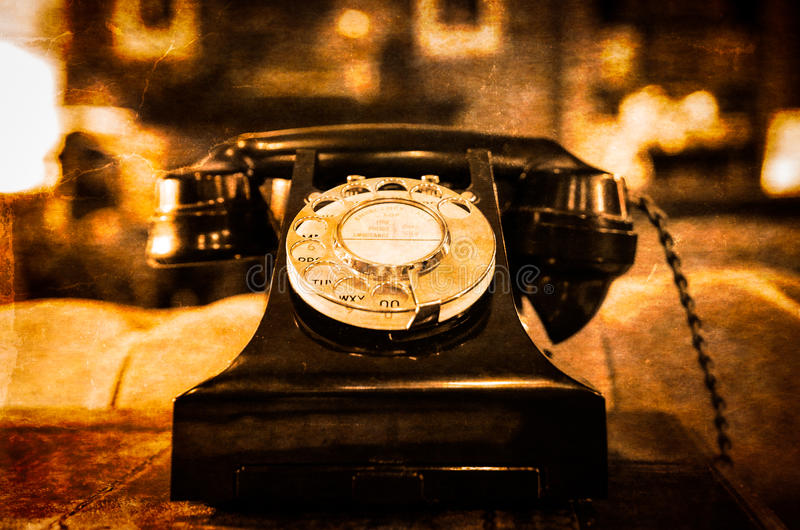 Detail view of old vintage dial telephone on the table. Blurred background royalty free stock photo