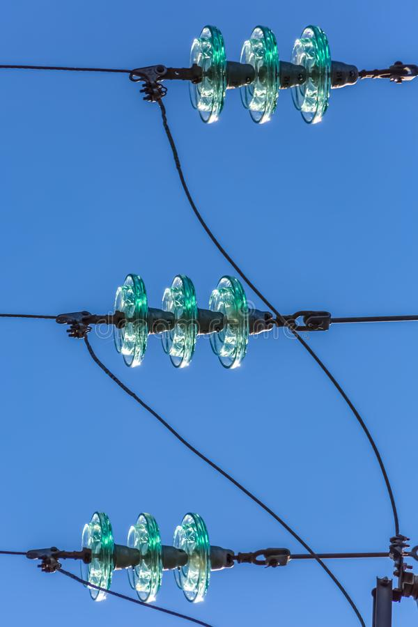 Detail view of a overhead arcing horns used on the electric tower. Blue sky on background, electricity, wire, power, detailed, details, three, texture, macro stock image