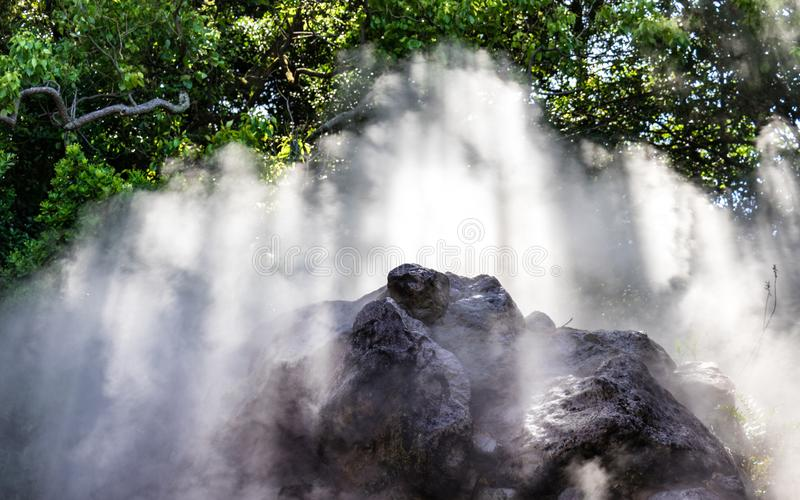 Detail view on steam of famous geothermal hot springs, called Tatsumaki Jigoku, engl. spout hell, in Beppu, Oita Prefecture, Japan. The `hells` jigoku of Beppu royalty free stock images