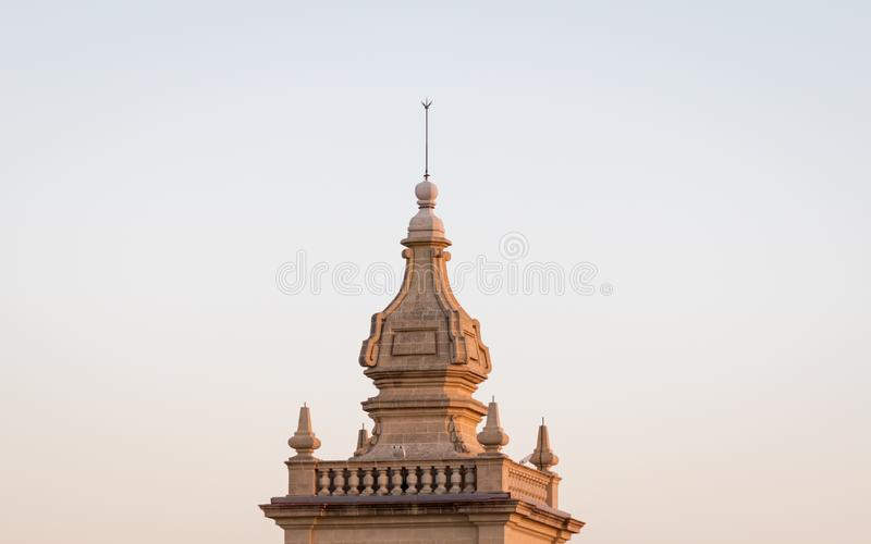 Detail view on the top roof of the antique tower of old, historical St. Joseph`s Chapel inside the Citadel of Victoria in Gozo, royalty free stock photo