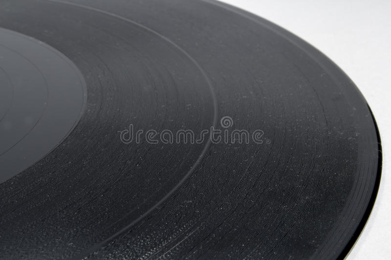 Detail view of vinyl record on white royalty free stock images