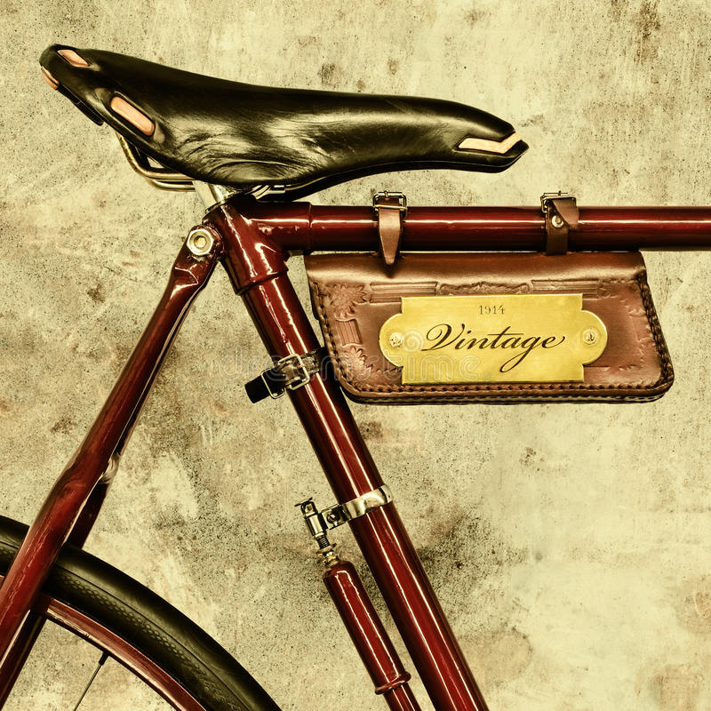 Detail of a vintage bicycle. With leather saddle and bag stock image