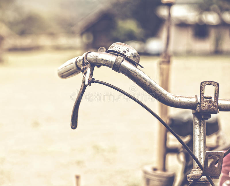 Detail of a Vintage Bicycle Resting in the countryside Street stock photo