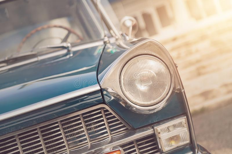 Detail of a vintage car. Close up of headlight retro classic car. Vintage effect style pictures. Classic car royalty free stock images