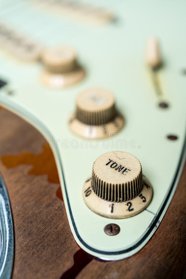Detail of vintage electric guitar tone knob stock image