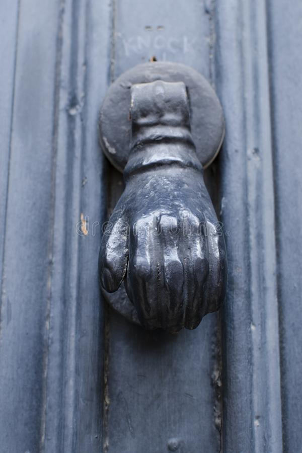 Detail of vintage metal front door fist knocking knob royalty free stock image
