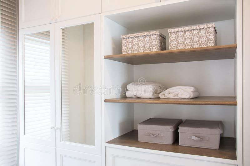 Detail of walk in closet with wardrobe. royalty free stock photography