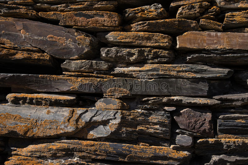 Detail of a wall of an ancient stone house.  stock photography