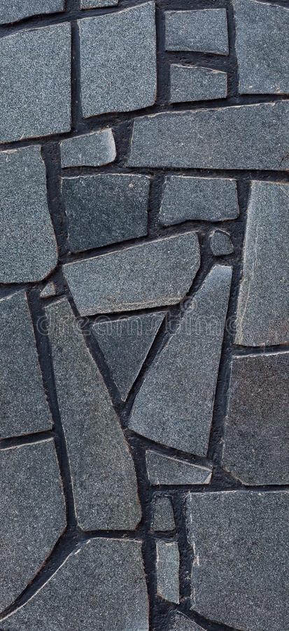 Detail of wall with decorative blue-gray stone tiles. Textural background royalty free stock images