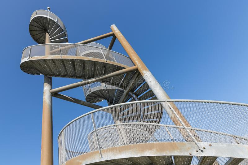 Watch-tower made of spiral staircases near Lelystad Airport, The Netherlands. Detail of watch tower made of two twisted steel spiral staircases near Lelystad royalty free stock image