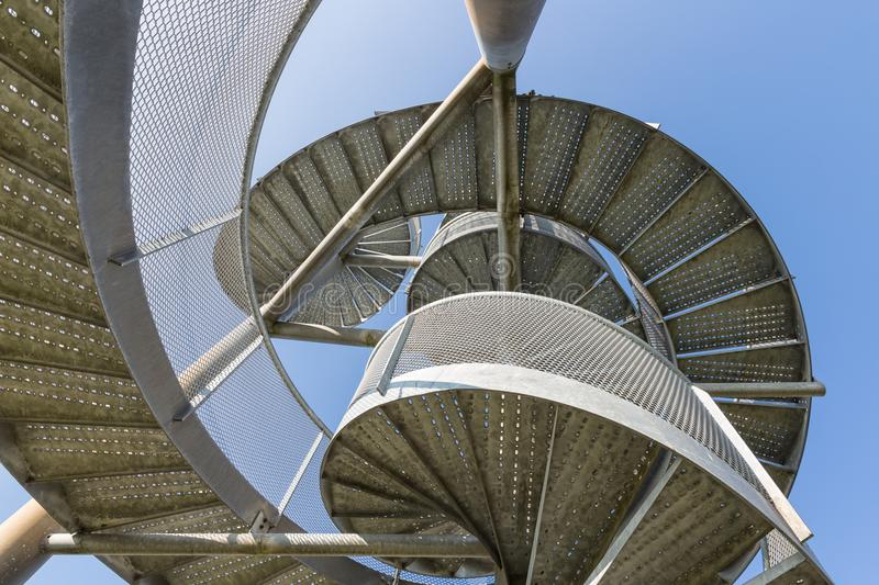 Watch-tower made of spiral staircases near Lelystad Airport, The Netherlands. Detail of watch tower made of two twisted steel spiral staircases near Lelystad royalty free stock photo