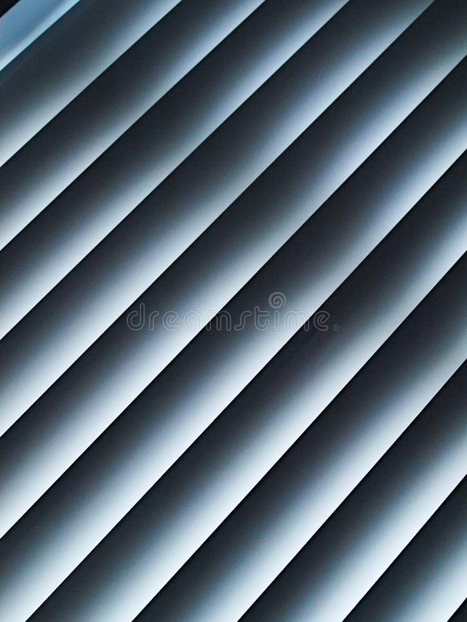 Detail of white diagonal blinds stock image