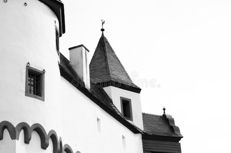 Detail of a white medieval castle with a black roof. Germany, Europe royalty free stock image