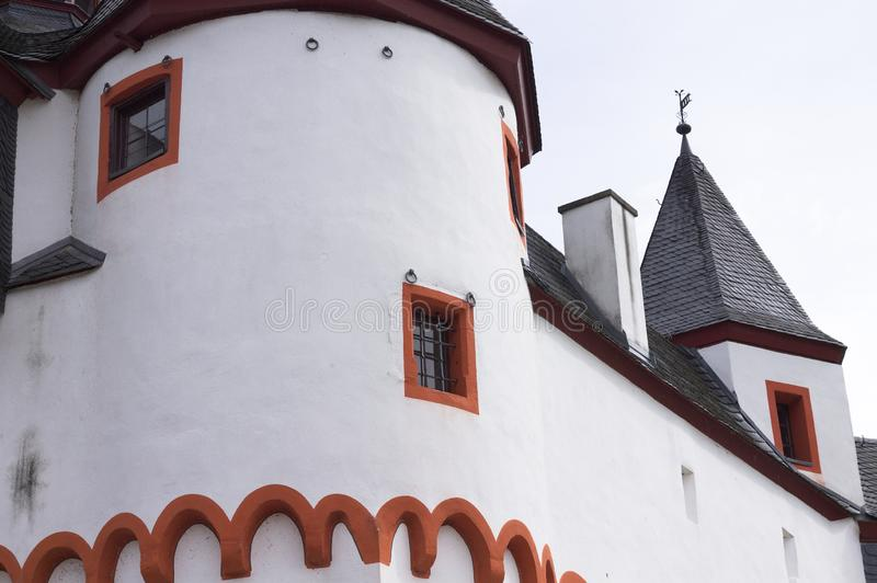 Detail of a white medieval castle with a black roof. Germany, Europe stock photography