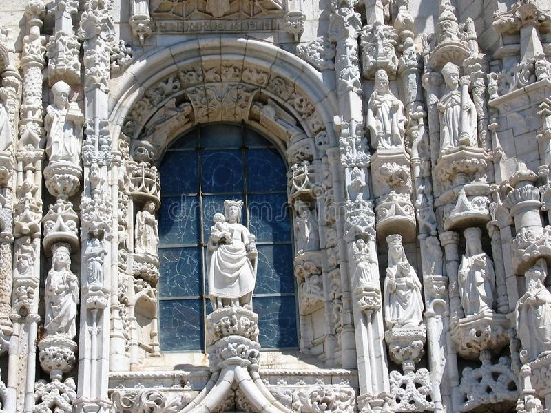 Detail of a white window in manuelino style of the monastery dos Jerónimos in the district of Belém in Lisbon in Portugal. royalty free stock photo