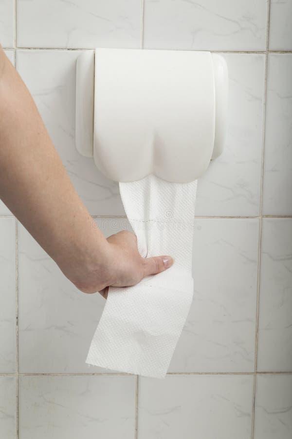 Using toilet paper stock image
