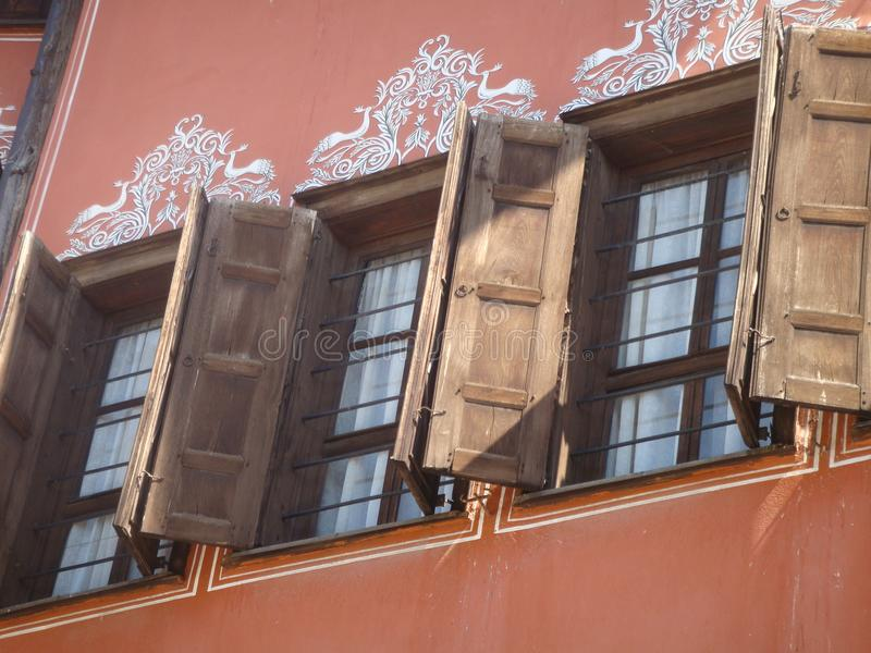 Detail of wood windows of the picturesque houses of Plovdiv in Bulgaria. royalty free stock photos