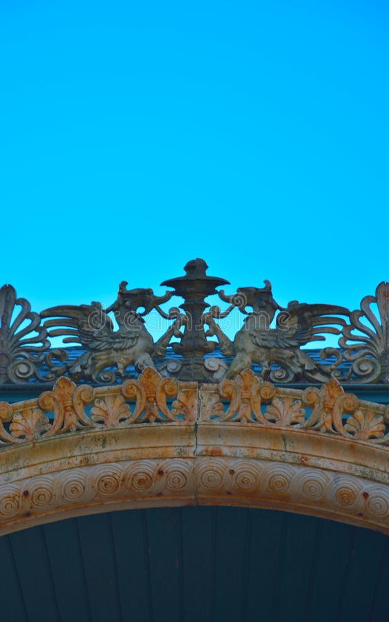 Detail of wooden ornaments, two mystical dragons. In the blue sky , detail of an ancient kiosk royalty free stock photos