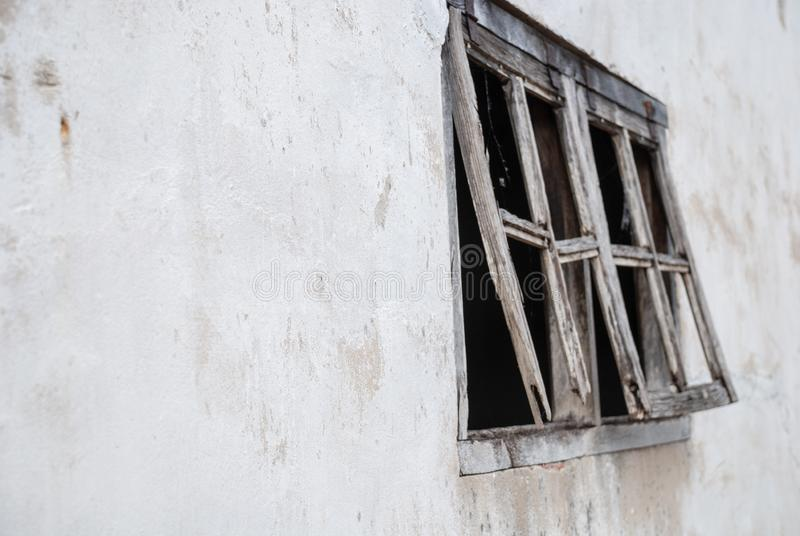 Detail of wooden windows of abandoned white house royalty free stock photography