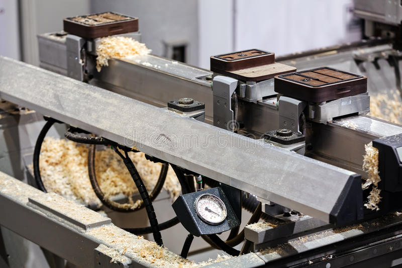 Detail of woodworking machine. Close up of stainless steel and aluminum woodworking machine stock photography