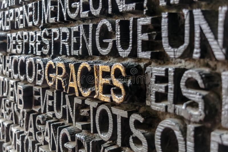 Detail of the bronze door of Passion facade of Sagrada Familia. Detail with word Gracies Thanks in catalan on the bronze door of Passion facade of Sagrada stock photo